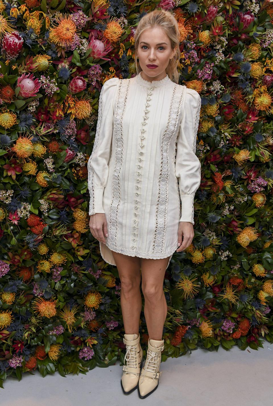 <p>The actress wore a short, lace panel white dress for the pre-NYFW event. <em>[Photo: Rex]</em> </p>