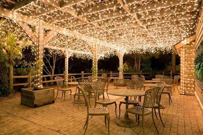 """<p>If you're planning to go all out for a special summer party, opt for a more extravagant look by hanging dozens of lights on a patio or porch's ceiling.</p><p><strong>See more at <a href=""""http://25mainstreet.com/products/17-meter-string-of-100-led-solar-powered-fairy-lights-1"""" rel=""""nofollow noopener"""" target=""""_blank"""" data-ylk=""""slk:25 Main Street"""" class=""""link rapid-noclick-resp"""">25 Main Street</a>.</strong></p><p><strong><a class=""""link rapid-noclick-resp"""" href=""""https://www.amazon.com/AmazonBasics-Commercial-Outdoor-Christmas-String/dp/B07TRM8WSY/ref=sr_1_3?tag=syn-yahoo-20&ascsubtag=%5Bartid%7C10050.g.3404%5Bsrc%7Cyahoo-us"""" rel=""""nofollow noopener"""" target=""""_blank"""" data-ylk=""""slk:Shop Christmas lights"""">Shop Christmas lights</a><br></strong></p>"""