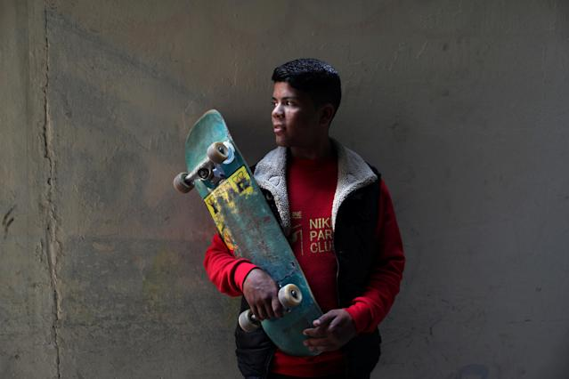 Palestinian Mustafa Sarhan, 19, a member of Gaza Skating Team, holds a skateboard as he poses for a portrait in his family house in Gaza City March 18, 2019. Picture taken March 18, 2019. REUTERS/Mohammed Salem