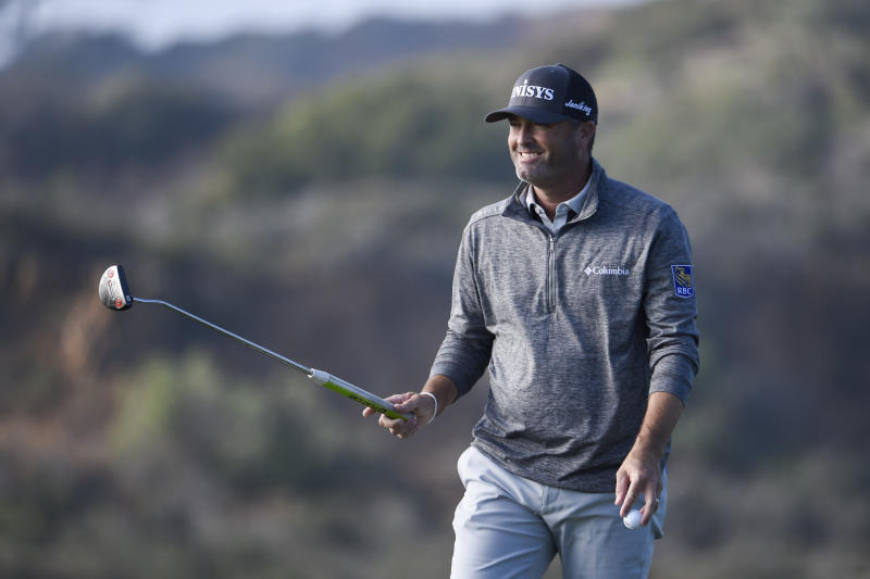 Ryan Palmer raises his putter after hitting a birdie putt on the 17th hole of the North Course at Torrey Pines Golf Course during the second round of the Farmers Insurance golf tournament Friday, Jan. 24, 2020, in San Diego. (AP Photo/Denis Poroy)
