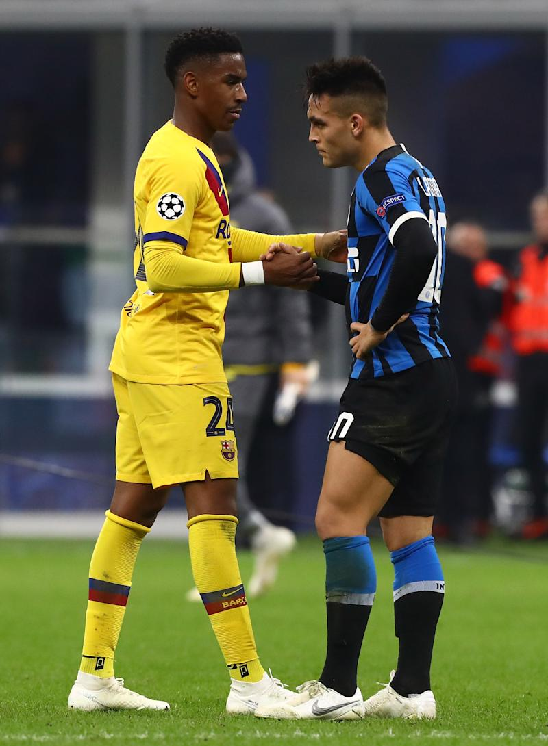 MILAN, ITALY - DECEMBER 10: Lautaro Martinez reacts with Junior Firpo of Barcelona at the end of the UEFA Champions League group F match between Inter and FC Barcelona at Giuseppe Meazza Stadium on December 10, 2019 in Milan, Italy. (Photo by Marco Luzzani - Inter/Inter via Getty Images)