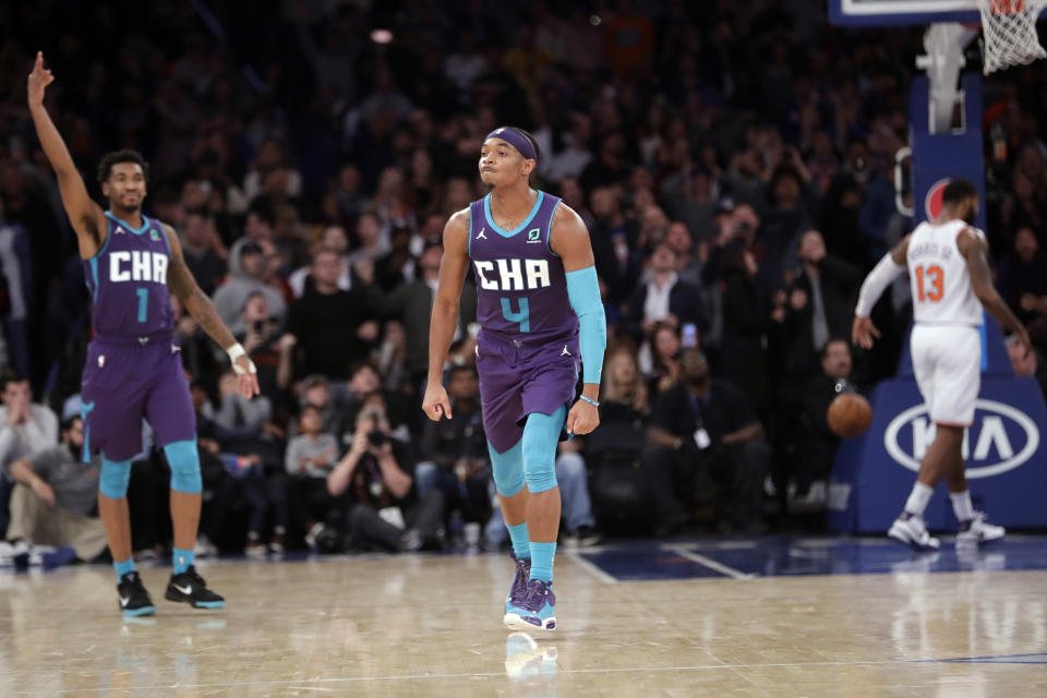 Charlotte Hornets' Devonte' Graham (4) and teammate Malik Monk (1) react after Graham made a 3-point basket during the second half of an NBA basketball game against the New York Knicks, Saturday, Nov. 16, 2019, in New York. The Hornets won 103-102. (AP Photo/Frank Franklin II)