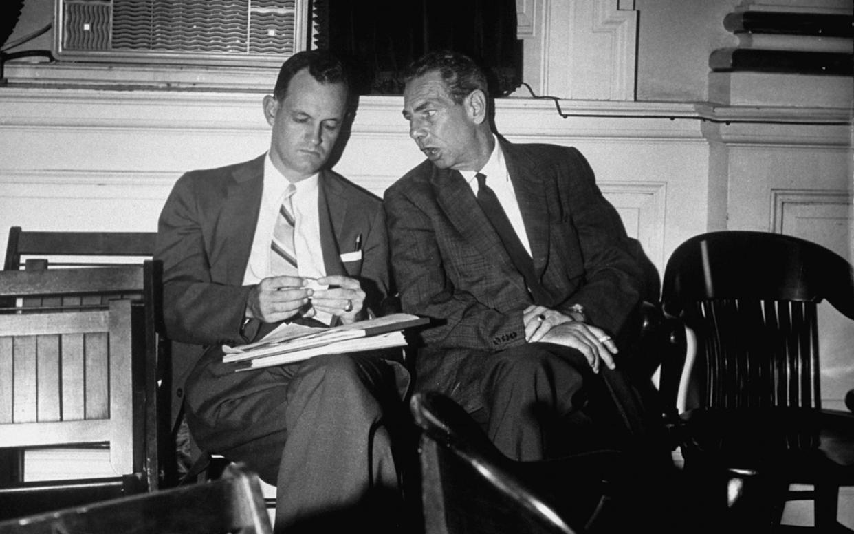 Sen. Mills Godwin, left, speaks with an unidentified man during his support of bills introduced to state legislature by Gov. Thomas B. Stanley in defiance of Supreme Court decision banning segregation in public schools. (Photo: Margaret Bourke-White/LIFE Picture Collection/Getty Images)