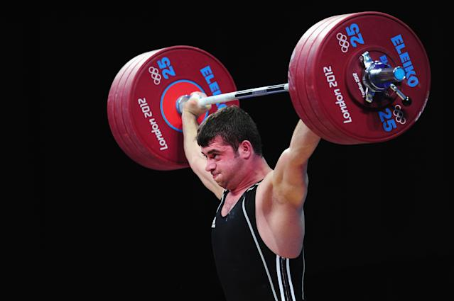LONDON, ENGLAND - AUGUST 04: Saeid Mohammadpourkarkaragh of Iran competes in the Men's 94kg Weightlifting final on Day 8 of the London 2012 Olympic Games at ExCeL on August 4, 2012 in London, England. (Photo by Mike Hewitt/Getty Images)