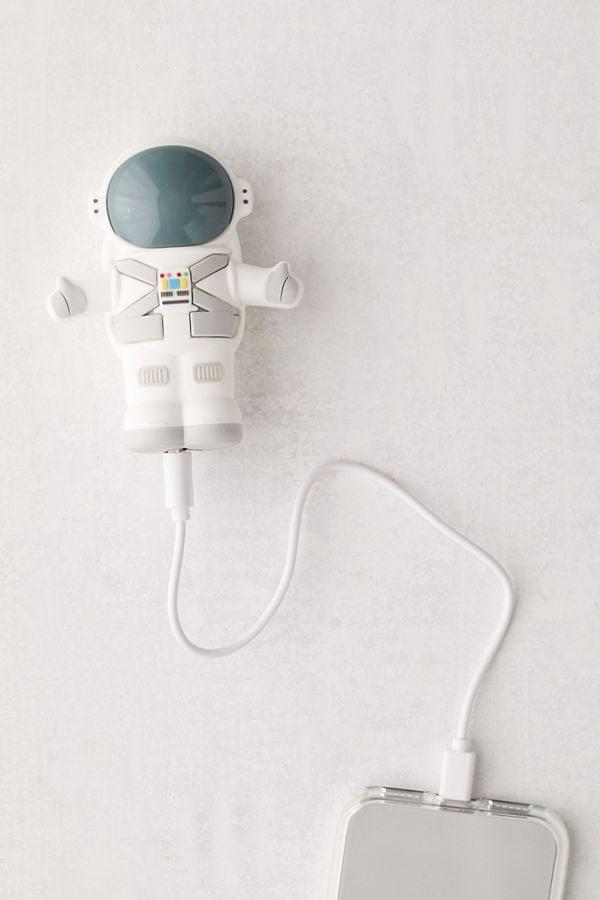 "<p>If his phone is always running out of battery, he'll be so happy to have this fun <a href=""https://www.popsugar.com/buy/MojiPower-Space-Boy-Portable-Power-Bank-504078?p_name=MojiPower%20Space%20Boy%20Portable%20Power%20Bank&retailer=urbanoutfitters.com&pid=504078&price=30&evar1=savvy%3Aus&evar9=45526638&evar98=https%3A%2F%2Fwww.popsugar.com%2Fhome%2Fphoto-gallery%2F45526638%2Fimage%2F46782060%2FMojiPower-Space-Boy-Portable-Power-Bank&list1=shopping%2Cgifts%2Choliday%2Cstocking%20stuffers%2Cgift%20guide%2Cgifts%20for%20men&prop13=api&pdata=1"" rel=""nofollow"" data-shoppable-link=""1"" target=""_blank"" class=""ga-track"" data-ga-category=""Related"" data-ga-label=""https://www.urbanoutfitters.com/shop/mojipower-space-boy-portable-power-bank?category=new-music-tech&amp;color=095&amp;type=REGULAR"" data-ga-action=""In-Line Links"">MojiPower Space Boy Portable Power Bank</a> ($30).</p>"