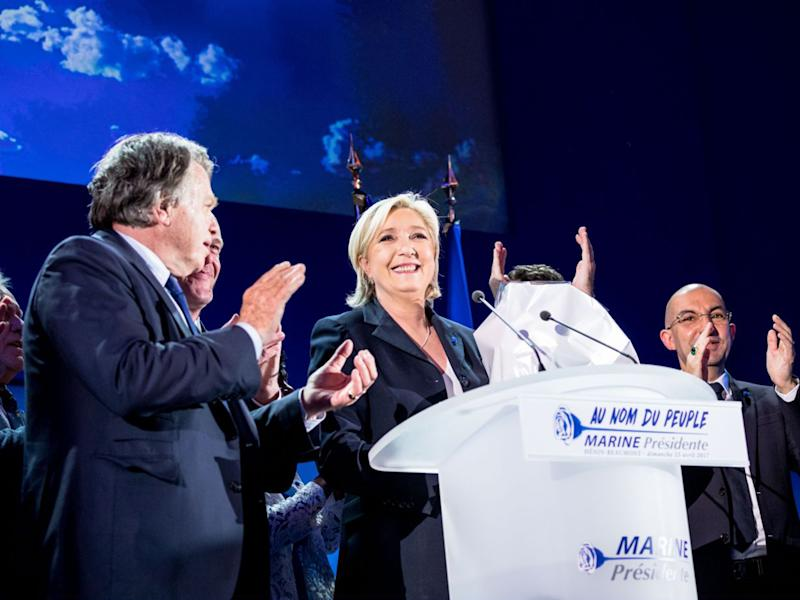 Marine Le Pen soaks up the applause from her supporters last night: Getty