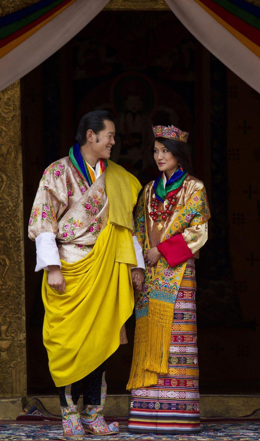 """<p>The Queen of Bhutan was married in a colorful Bhutanese kira, one of several that she wore during her <a href=""""https://www.washingtonpost.com/world/bhutans-royal-wedding/2011/10/12/gIQApfCkfL_gallery.html?utm_term=.ea52b2ff75f5"""" rel=""""nofollow noopener"""" target=""""_blank"""" data-ylk=""""slk:three day wedding celebration"""" class=""""link rapid-noclick-resp"""">three day wedding celebration</a>.</p>"""