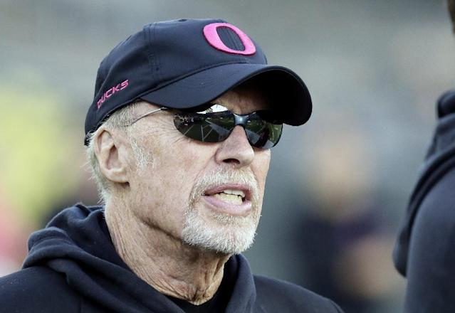 Nike founder and Oregon alumni Phil Knight sports a pink Oregon hat on the sidelines before an NCAA college football game against Washington State in Eugene, Ore., Saturday, Oct. 19, 2013. (AP Photo/Don Ryan)