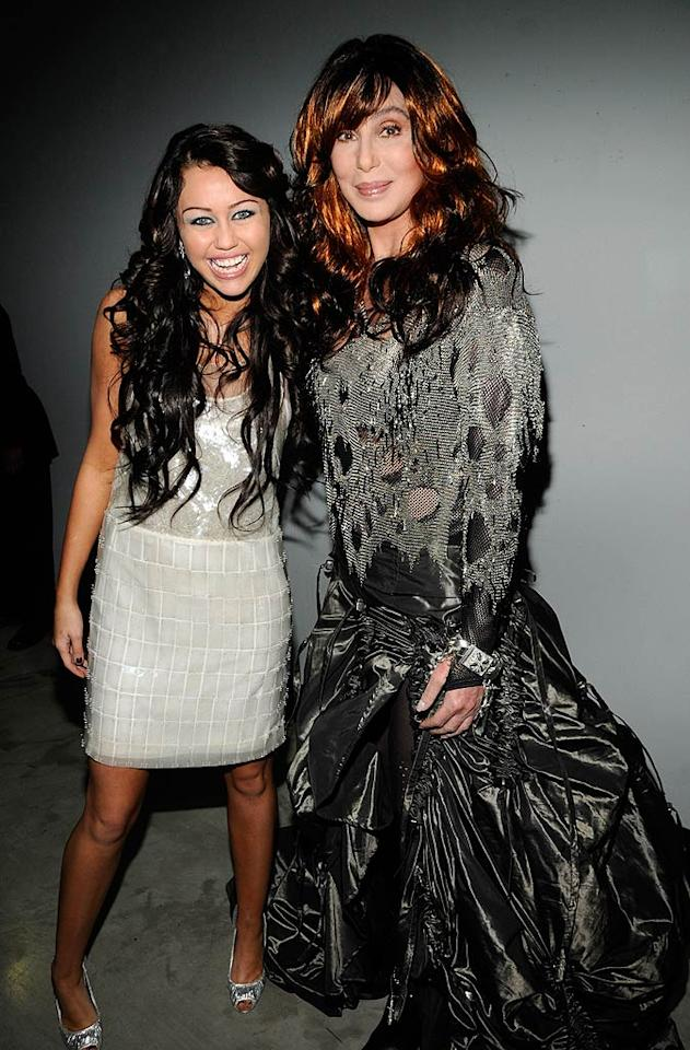 """Hannah Montana"" was H-O-T! And so was Miley. The 15-year-old songstress shared a hug with another multitalented star, Cher, backstage at the Grammy Awards in February 2008. Kevin Mazur/<a href=""http://www.wireimage.com"" target=""new"">WireImage.com</a> - February 10, 2008"