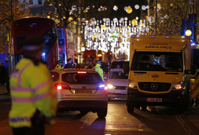 <p>Police officers and vehicles block Oxford Street in the west end of London after Oxford Circus station was evacuated Friday Nov. 24, 2017. (Photo: Alastair Grant/AP) </p>