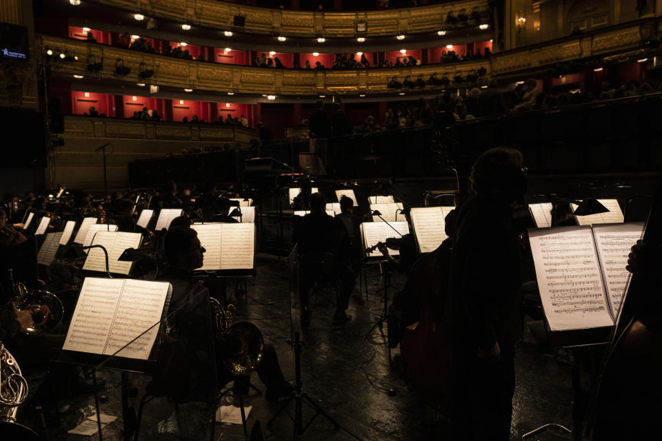 "The orchestra warms up prior to a performance of ""Rusalka"" at the Teatro Real in Madrid, Spain, on Thursday, Nov. 12, 2020. The theater is one of the few major opera houses that have reopened during the coronavirus pandemic, although to smaller audiences. (AP Photo/Bernat Armangue)"
