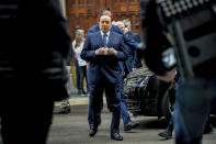 Forza Italia leader Silvio Berlusconi arrives at polling station in Milan, Italy, Sunday, Oct. 3, 2021. Millions of people in Italy started voting Sunday for new mayors, including in Rome and Milan, in an election widely seen as a test of political alliances before nationwide balloting just over a year away. (Claudio Furlan/LaPresse via AP)