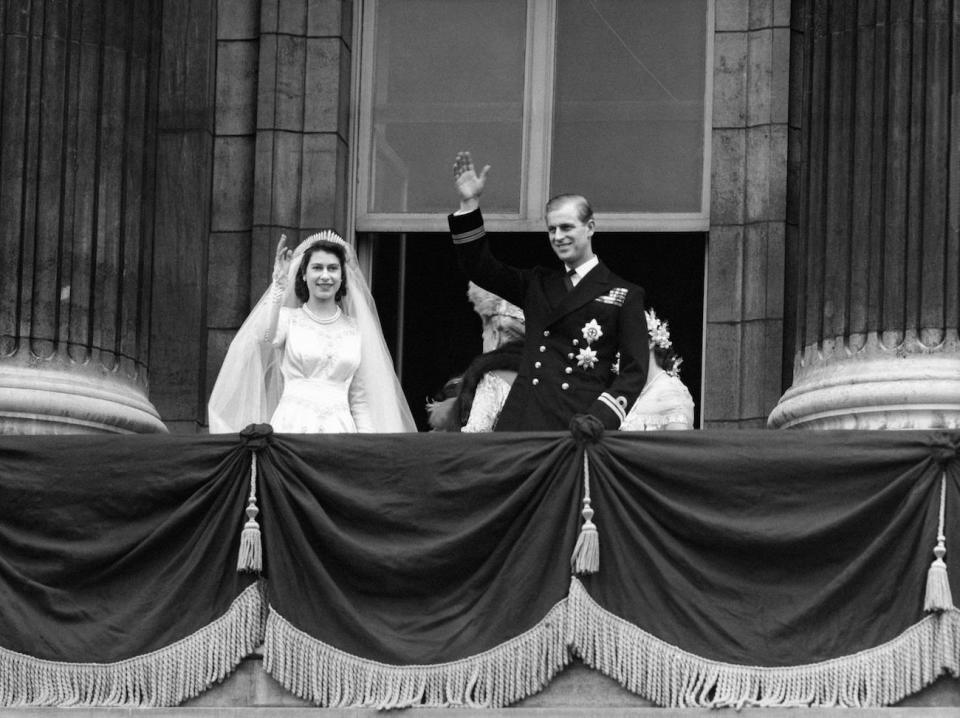 <p>The bride, Princess Elizabeth and groom, the newly created Duke of Edinburgh on the balcony of Buckingham Palace after they were married in a ceremony at Westminster Abbey (PA Archive) </p>