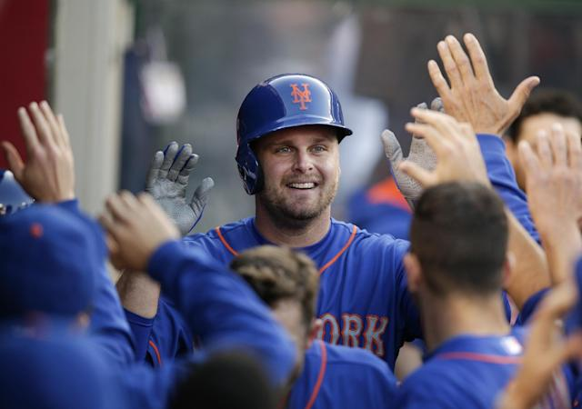 New York Mets' Lucas Duda, center, celebrates his home run with teammates during the second inning of a baseball game against the Los Angeles Angels on Saturday, April 12, 2014, in Anaheim, Calif. (AP Photo/Jae C. Hong)