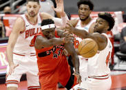 Toronto Raptors forward Pascal Siakam (43) passes the ball past Chicago Bulls' Patrick Williams, right, during the second half of an NBA basketball game Thursday, April 8, 2021, in Tampa, Fla. (AP Photo/Jason Behnken)