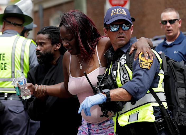 """<p>Rescue workers assist a victim who was injured when a car drove through a group of counter protestors at the """"Unite the Right"""" rally Charlottesville, Va., Aug. 12, 2017. (Photo: Joshua Roberts/Reuters) </p>"""