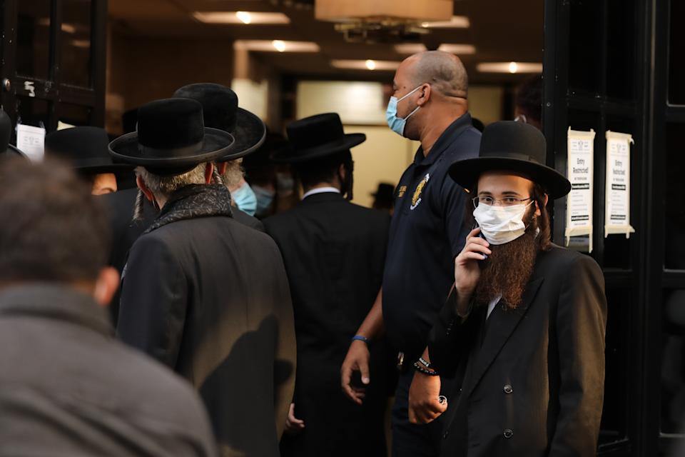 Pictured are people wearing masks in New York City.