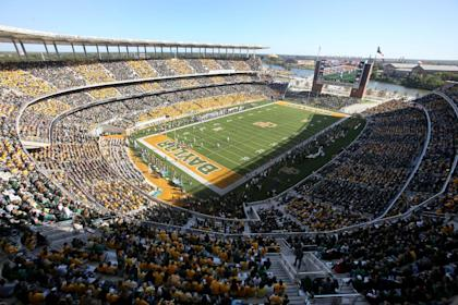 Fans watch a NCAA college football game against Kansas and Baylor inside McLane Stadium in the first half of an NCAA college football game, Saturday, Nov. 1, 2014, in Waco, Texas. (AP Photo/ Jerry Larson)
