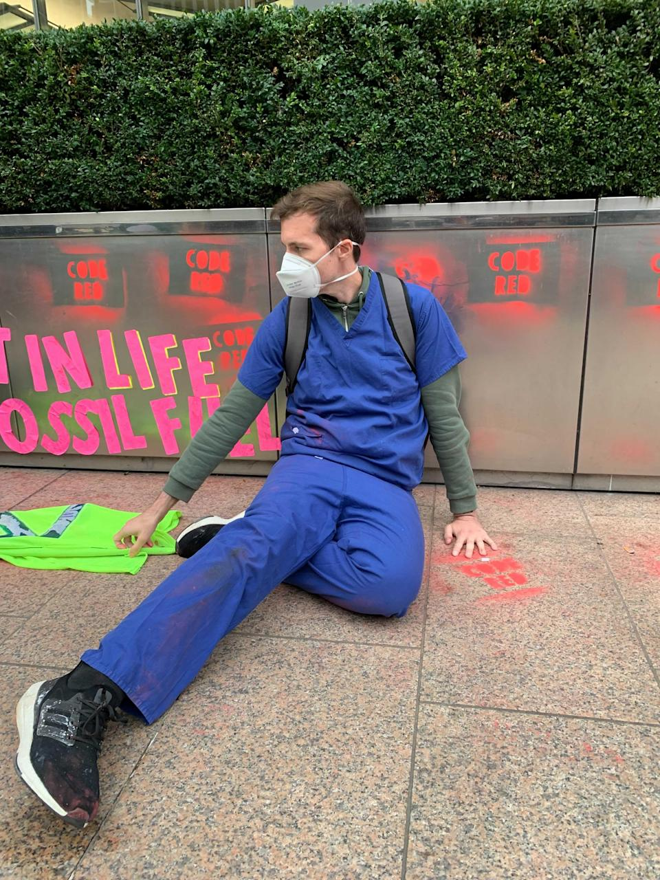 Protesters glued their hands to the floor or to flower boxes (The Independent)