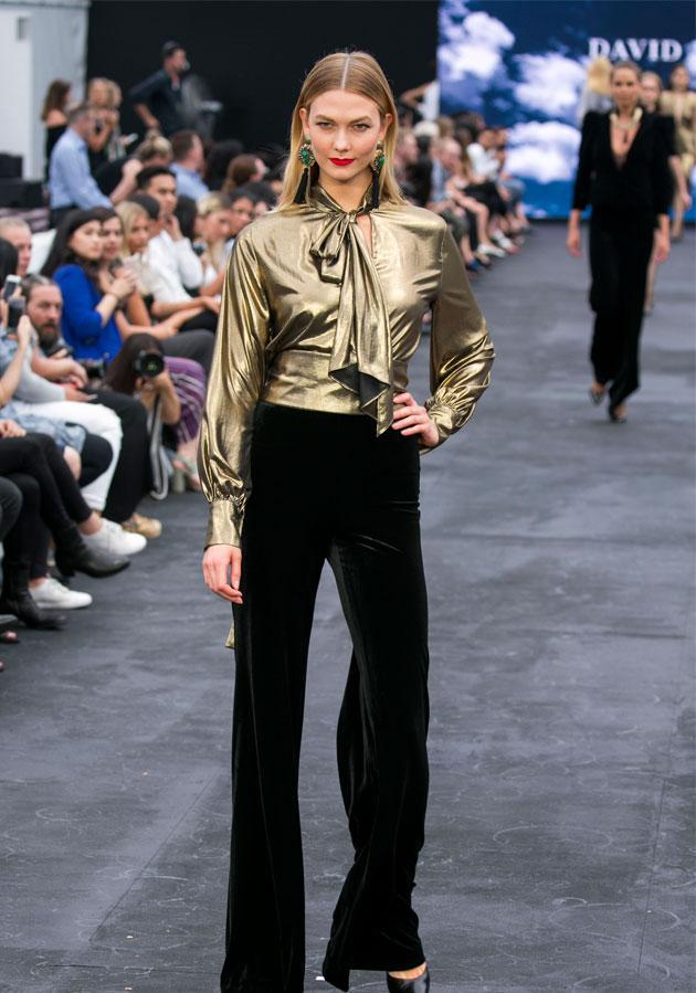 The American supermodel slayed the runway in sexy black velvet Carla Zampatti pants and a gold blouse.