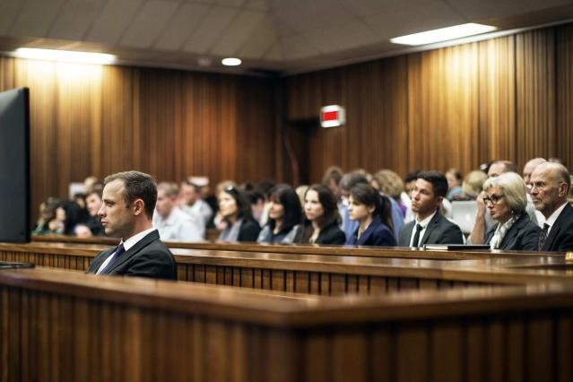 Olympic and Paralympic track star Oscar Pistorius looks on during the fourth day of his trial for the murder of his girlfriend Reeva Steenkamp at the North Gauteng High Court in Pretoria, March 6, 2014. REUTERS/Marco Longari/Pool (SOUTH AFRICA - Tags: SPORT ATHLETICS CRIME LAW)