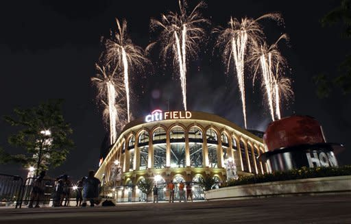 A pyrotechnics display lights the sky after a baseball game between the New York Mets and the Philadelphia Phillies, Tuesday, July 3, 2012, in New York. The Mets won 11-1. (AP Photo/Frank Franklin II)