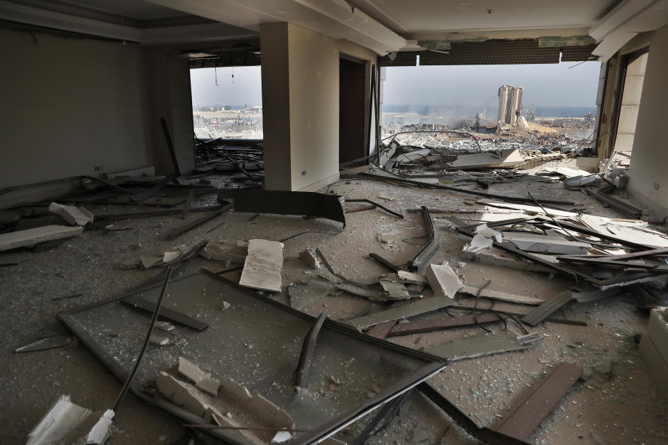 "The scene of the explosion that hit the seaport of Beirut is seen through a damaged apartment in Beirut, Lebanon, Wednesday, Aug. 5, 2020. Prime Minister Hassan Diab, in a short televised speech, has appealed to all countries and friends of Lebanon to extend help to the small nation, saying: ""We are witnessing a real catastrophe."" (AP Photo/Hussein Malla)"