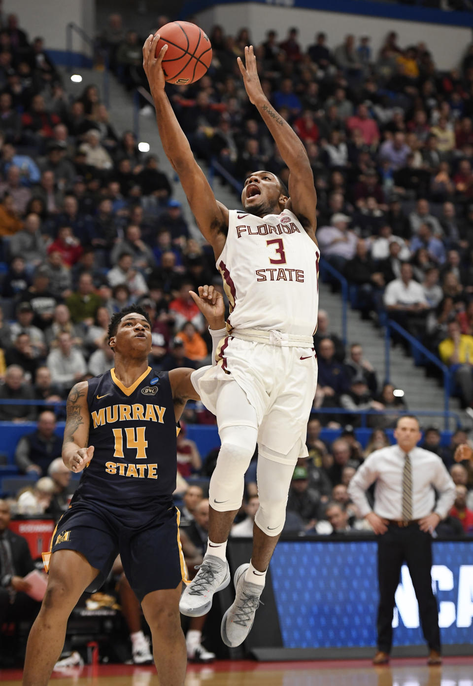 Florida State's Trent Forrest (3) shoots a basket over Murray State's Jaiveon Eaves (14) during the first half of a second round men's college basketball game in the NCAA tournament, Saturday, March 23, 2019, in Hartford, Conn. (AP Photo/Jessica Hill)