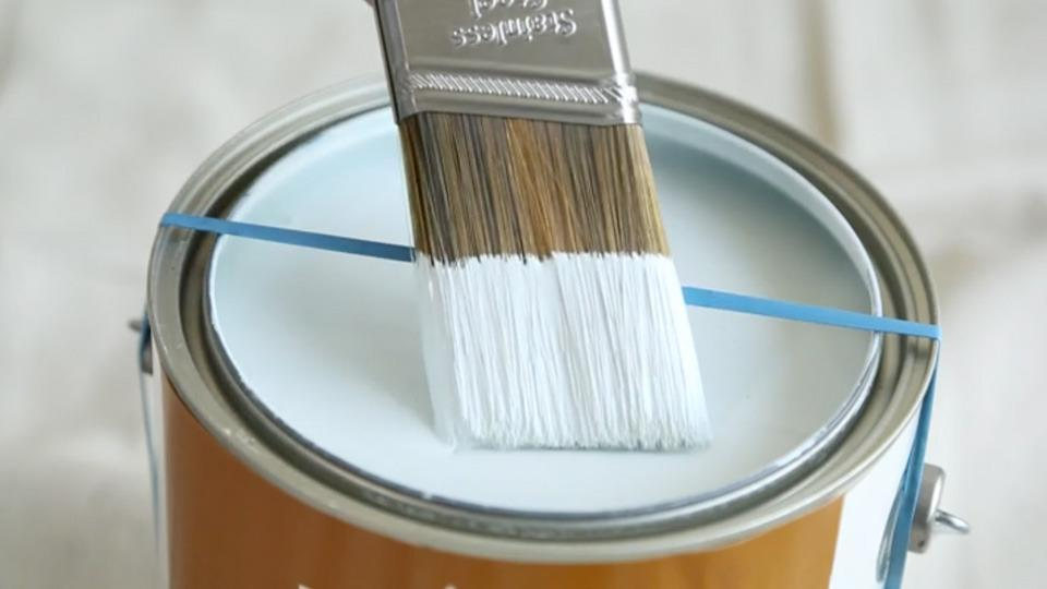 Stretch a rubber band across a paint can to remove excess paint from your brush. Also, rest your brush against it and the rim of the can when not in use.