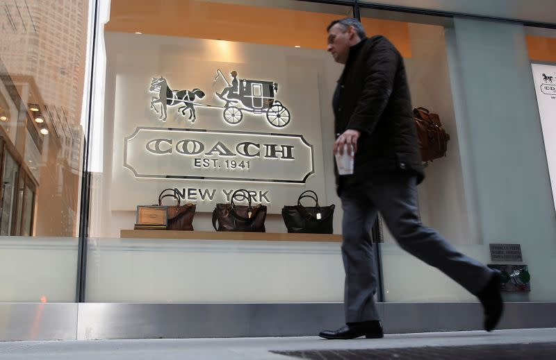 FILE PHOTO: A man walks past a Coach store on Madison Avenue in New York