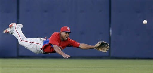 Philadelphia Phillies center fielder Ben Revere (2) can't make the catch on a ball from New York Yankees' Ichiro Suzuki in the second inning of a spring training baseball game in Tampa, Fla., Wednesday, March 13, 2013. (AP Photo/Kathy Willens)