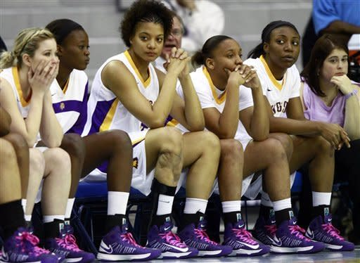 Tennessee Tech player's watch the final seconds of the championship game against Tennessee Martin in the Ohio Valley Conference NCAA college basketball tournament on Saturday, March 9, 2013, in Nashville, Tenn. Tennessee Martin won 87-80 in overtime for their third consecutive championship. (AP Photo/Wade Payne)