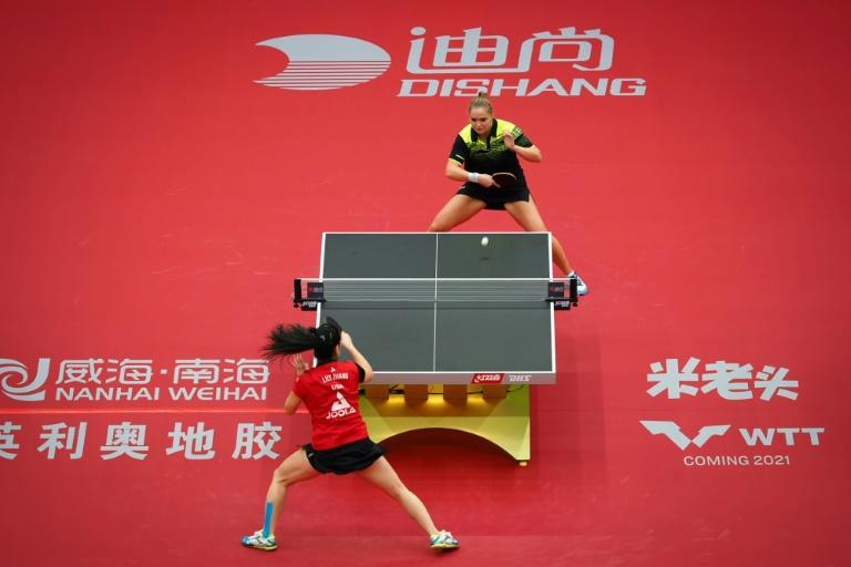Lily Zhang (in red) of the United States plays Margaryta Pesotska of Ukraine at the 2020 ITTF Women's World Cup in Weihai, the first event on the sport's world tour since the virus shutdown