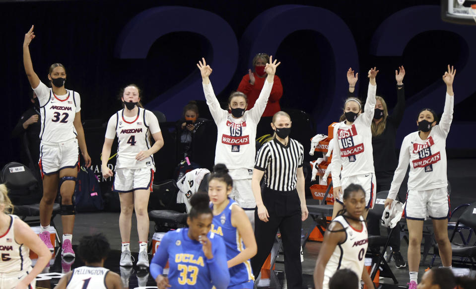 The Arizona bench reacts after a teammate's 3-point shot during the second half of an NCAA college basketball game against UCLA in the semifinals of the Pac-12 women's tournament Friday, March 5, 2021, in Las Vegas. (AP Photo/Isaac Brekken)