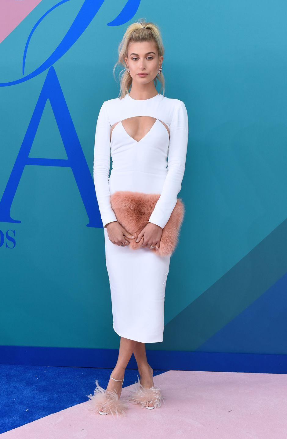 "<p>Hailey Baldwin<span class=""redactor-invisible-space""> wore a white Cushnie Et Ochs dress to attend the 2017 CFDA Fashion Awards.</span></p>"