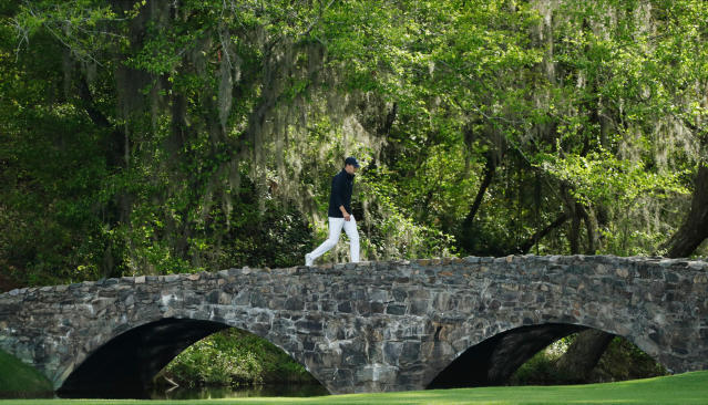 Jordan Spieth walks across the Nelson Bridge on the 13th hole during the fourth round at the Masters golf tournament Sunday, April 8, 2018, in Augusta, Ga. (AP Photo/David J. Phillip)