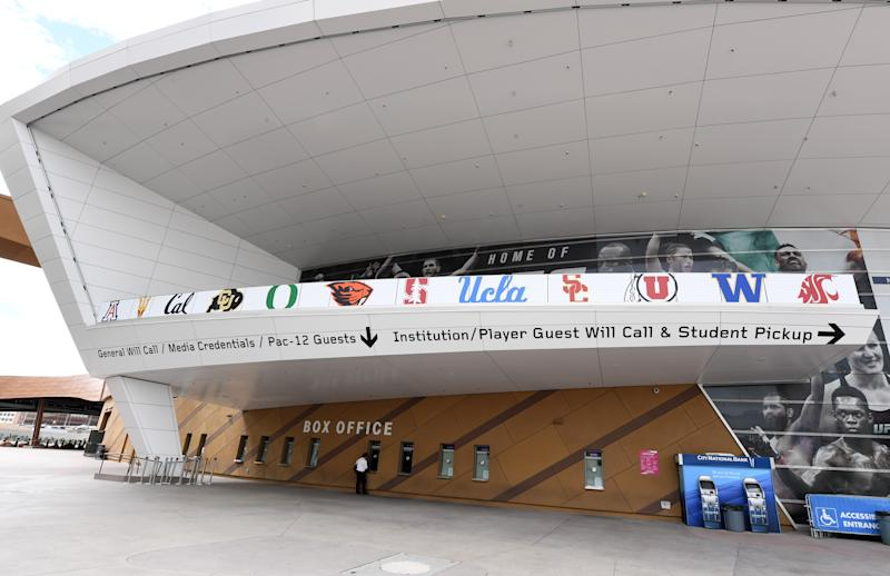 Pac-12 logos outside of a basketball arena box office.