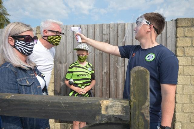A fan gets his temperature tested ahead of a game at Forest Green