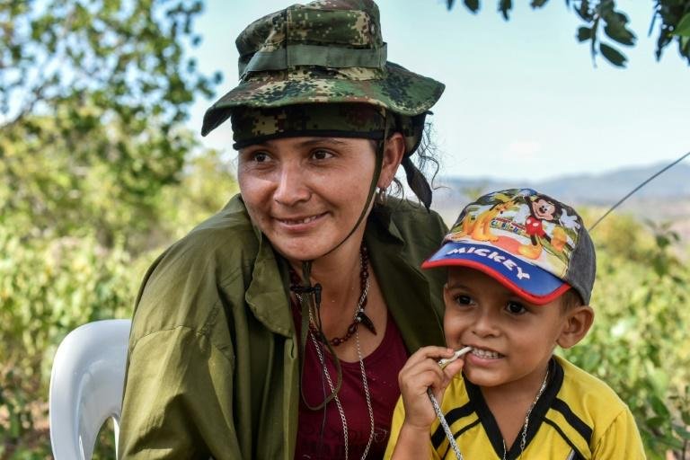 At camps where FARC are disarming under a peace deal guerrillas in combats play with children as a baby boom hit FARC after peace talks with Colombian government opened in 2012