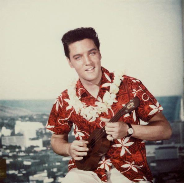 """<p>Presley traveled to Hawaii to film <em>Blue Hawaii</em> in 1961. The movie was a hit and the accompanying album was his best-selling album, selling <a href=""""https://www.graceland.com/1958-1961"""" rel=""""nofollow noopener"""" target=""""_blank"""" data-ylk=""""slk:2 million copies in the first 12 months"""" class=""""link rapid-noclick-resp"""">2 million copies in the first 12 months</a>. One of his most successful singles """"Can't Help Falling in Love with You"""" was recorded for the film. Afterward, the South Pacific state became a favorite vacation spot for him.</p>"""