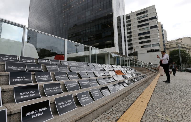 FILE PHOTO: Placards with names of victims of a collapsed tailings dam owned by Vale SA are placed in front of the Brazilian mining company Vale SA bulding, during an assembly of shareholders, in Rio de Janeiro