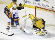 Nashville Predators goalie Pekka Rinne (35), of Finland, blocks a shot in front of New York Islanders right wing Michael Grabner (40), of Austria, in the second period of an NHL hockey game Thursday, March 5, 2015, in Nashville, Tenn. (AP Photo/Mark Humphrey)