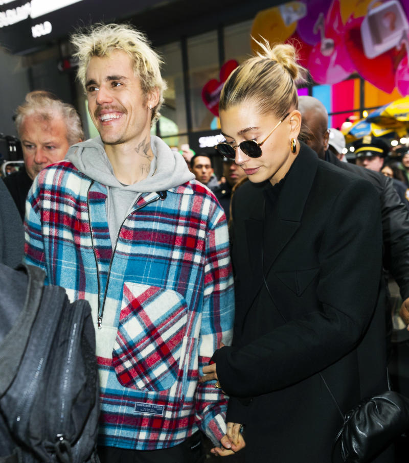 Hailey Bieber (wearing Jennifer Fisher hoops) with husband Justin Bieber in New York City. (Photo by Gotham/GC Images)