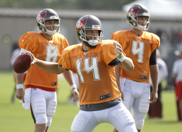 Tampa Bay Buccaneers quarterback Ryan Fitzpatrick (14) passes during a combined NFL football training camp with the Tennessee Titans Wednesday, Aug. 15, 2018, in Nashville, Tenn. (AP Photo/Mark Humphrey)