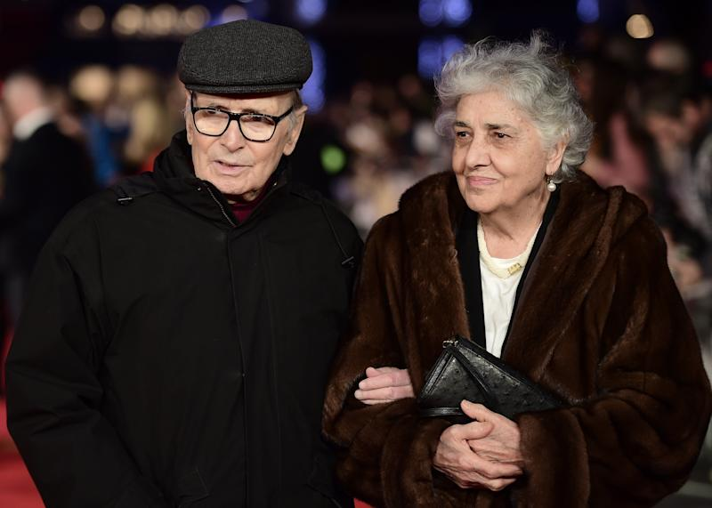 Italian composer Ennio Morricone poses with his wife Maria Travia on the red carpet of the European premiere of film 'The Hateful Eight' in London on December 10, 2015. AFP PHOTO / LEON NEAL (Photo by LEON NEAL / AFP) (Photo credit should read LEON NEAL/AFP via Getty Images) (Photo: LEON NEAL via Getty Images)