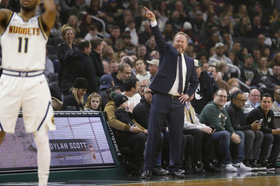 Milwaukee Bucks coach Mike Budenholzer gestures from the sideline during the first half of the team's NBA basketball game against the Denver Nuggets Friday, Jan. 31, 2020, in Milwaukee. (AP Photo/Aaron Gash)