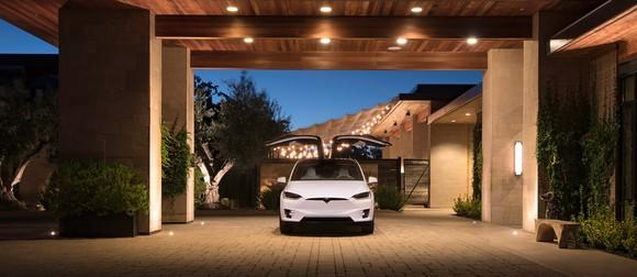 A Model X with its falcon wing doors open