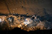 Rescuers in northern India hope there are air pockets in the blocked tunnel where dozens were trapped by mud and debris following a flash flood