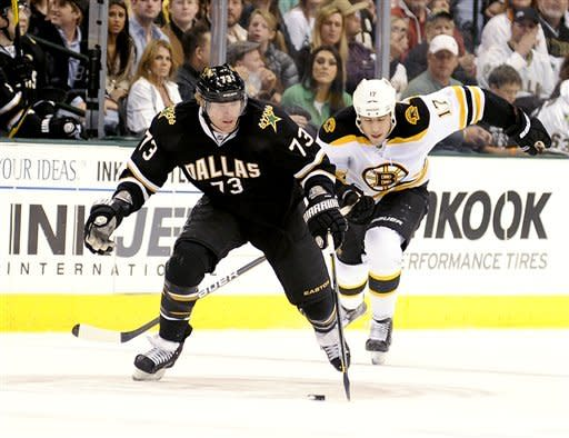 Dallas Stars right wing Michael Ryder (73) brings the puck up ice in front of Boston Bruins left wing Milan Lucic (17) in the first period during an NHL hockey game on Saturday, Dec. 31, 2011, in Dallas. The Stars won 4-2. (AP Photo/Matt Strasen)