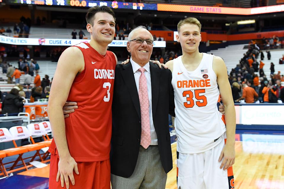 Cornell Big Red forward Jimmy Boeheim (3) and Syracuse Orange head coach Jim Boeheim and Syracuse Orange guard Buddy Boeheim (35) pose for a photo following the game at the Carrier Dome.